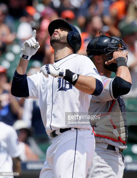 D Martinez of the Detroit Tigers passes catcher Yan Gomes of the Cleveland Indians while celebrating his solo home run during the third inning of...