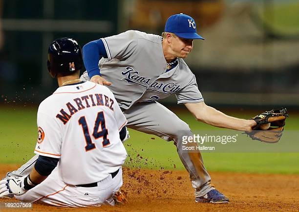 D Martinez of the Houston Astros is safe at second base during the fifth inning under the tag of Elliot Johnson of the Kansas City Royals at Minute...