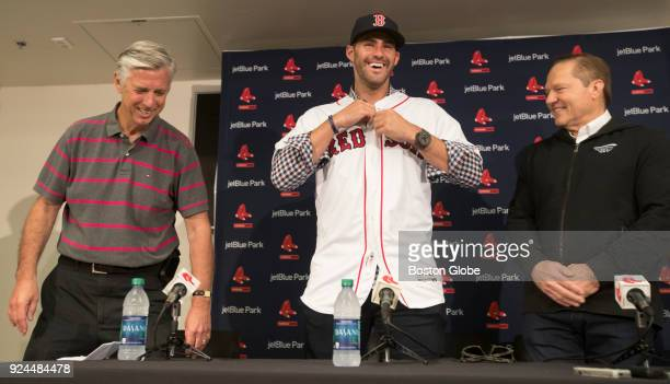 D Martinez puts on his new Red Sox jersey as Boston Red Sox general manager Dave Dombrowski and agent Scott Boras are all smiles during a press...