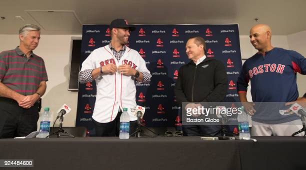 D Martinez puts on his new Red Sox jersey as Boston Red Sox general manager Dave Dombrowski his agent Scott Boras and Alex Cora are all smiles during...