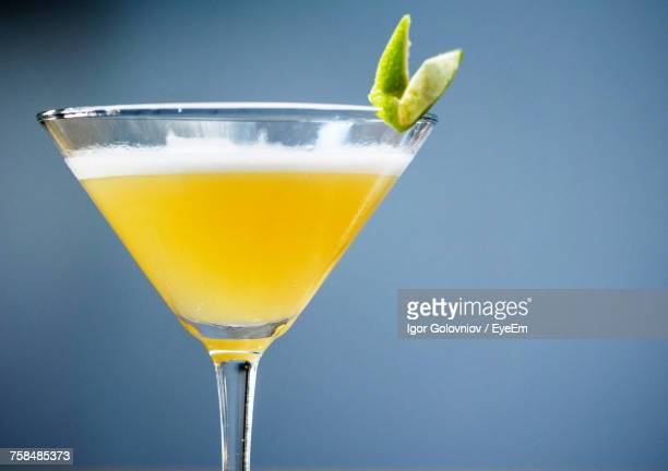 Martini Cocktail In Glass Against Blue Background