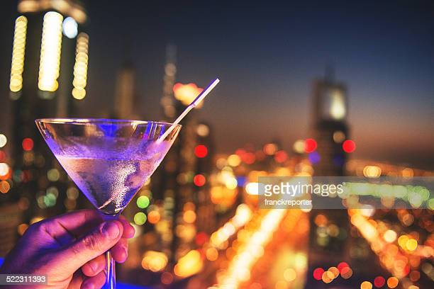 martini drink with city lights of Dubai downtown