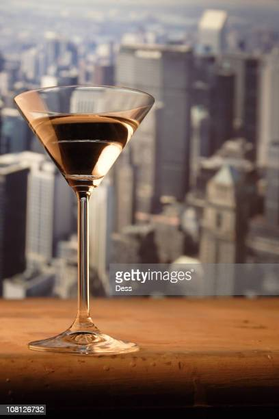 Martini Glass on Railing with New York Skyline in Background