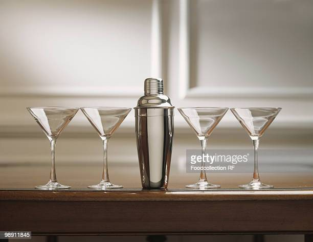 Martini glasses with cocktail shaker.