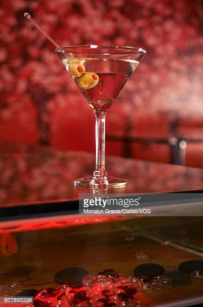 martini on top of aquarium - koi painting stock photos and pictures