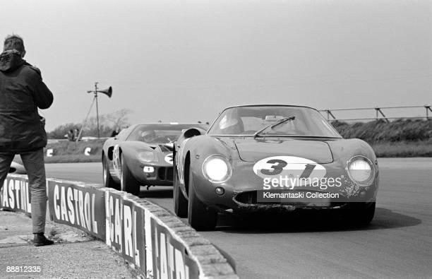 Martini Trophy Silverstone May 15 1967 Headlights blazing to warn slower cars David Piper hustles his wellknown Ferrari 250LM through Copse ahead of...