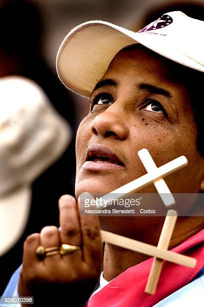 A Martinican faithful attends Pope Benedict XVI's audience in St Peter's Square at the Vatican waiting for the Pontiff's blessing of the Easter Holy...
