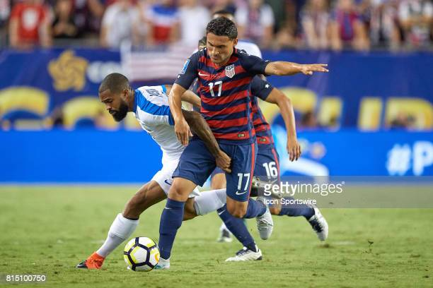 Martinique forward Kevin Parsemain and United States midfielder Cristian Roldan battle for the ball during a CONCACAF Gold Cup Group B match between...
