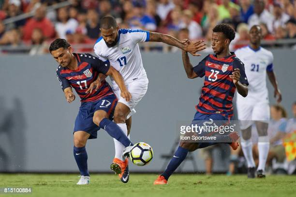 Martinique forward Kevin Parsemain battles with United States midfielder Cristian Roldan and United States defender Kellyn Acosta during a CONCACAF...