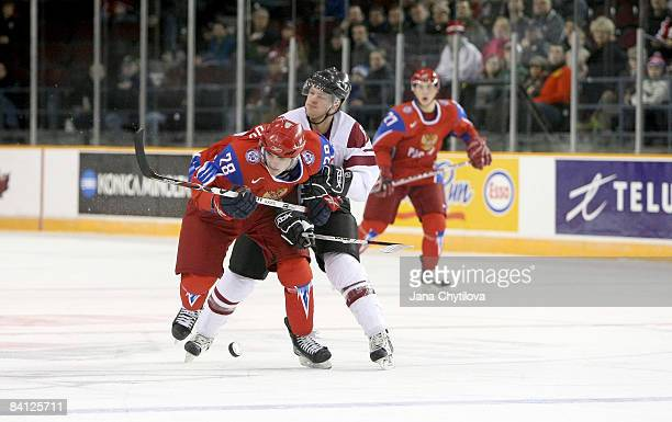 Martins Gipters of Latvia tries to slow down Nikita Filatov of Russia at the Civic Centre on December 26, 2008 in Ottawa, Ontario, Canada.
