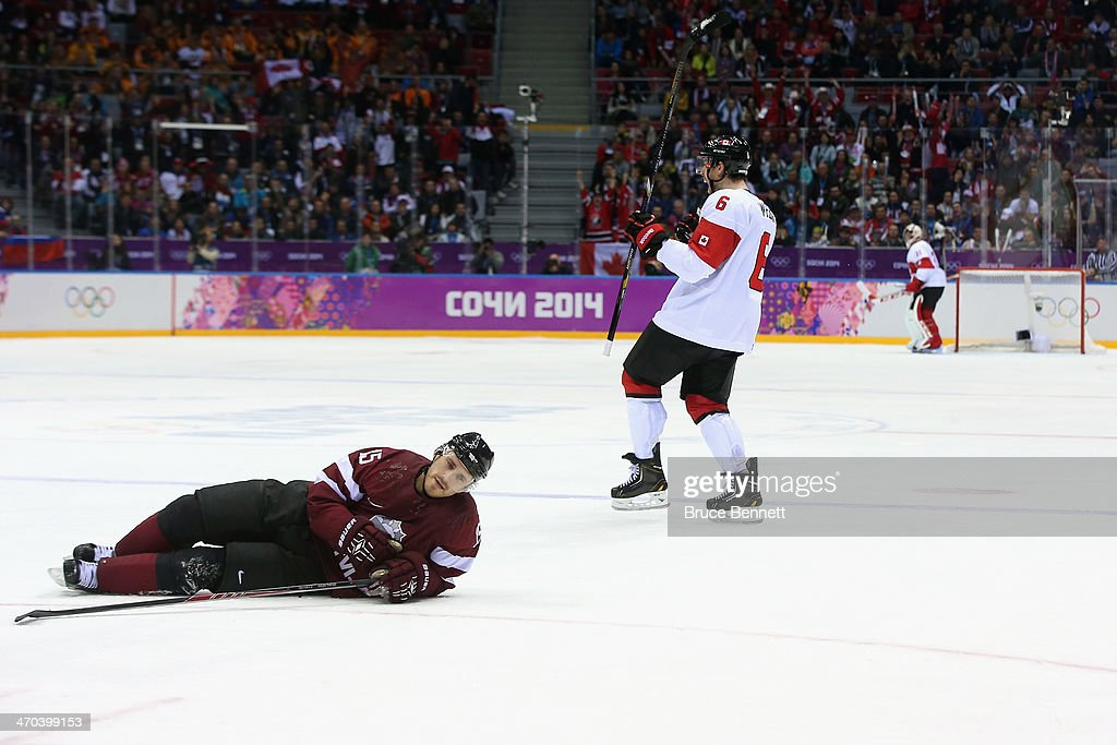 Martins Karsums #15 of Latvia reacts as Shea Weber #6 of Canada celebrates his third-period goal during the Men's Ice Hockey Quarterfinal Playoff on Day 12 of the 2014 Sochi Winter Olympics at Bolshoy Ice Dome on February 19, 2014 in Sochi, Russia.