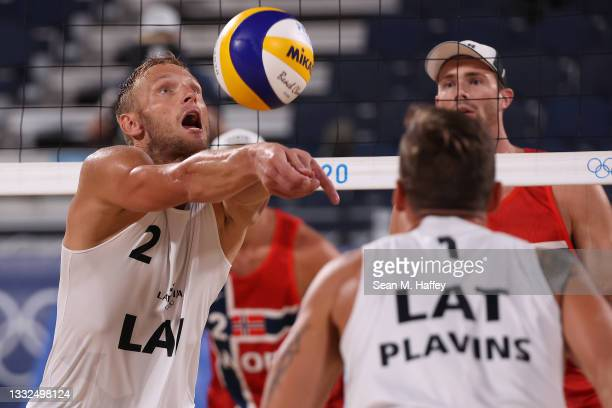 Martins Plavins and Edgars Tocs of Team Latvia compete against Team Norway during Men's Semifinal beach volleyball on day thirteen of the Tokyo 2020...