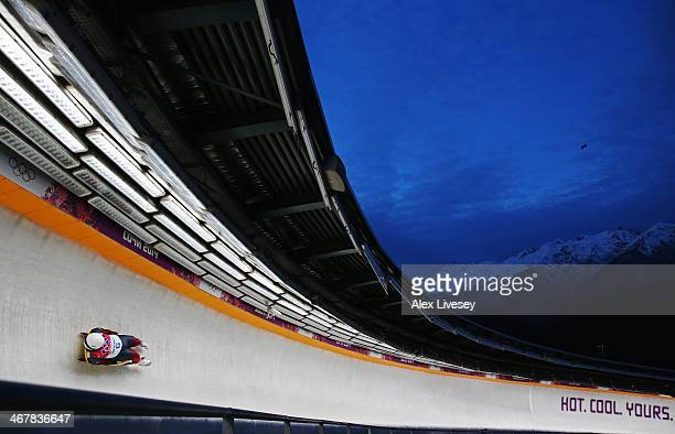 Martins Rubenis of Latvia makes a run during the Luge Men's Singles on Day 1 of the Sochi 2014 Winter Olympics at the Sliding Center Sanki on...