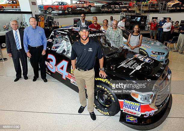 Martinsville president Clay Campbell, NASCAR Hall of Fame executive director Winston Kelley, driver Darrell Wallace Jr. And members of the Scott...