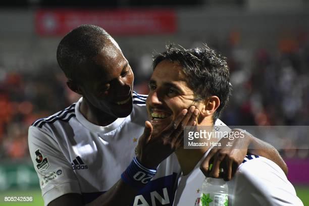 Martinus and Hugo Vieira of Yokohama F.Marinos celebrate their 2-1 victory after the J.League J1 match between Omiya Ardija and Yokohama F.Marinos at...