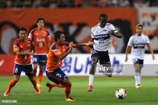 Martinus of Yokohama FMarinos and Teruki Hara of Albirex Niigata compete for the ball during the JLeague J1 match between Albirex Niigata and...