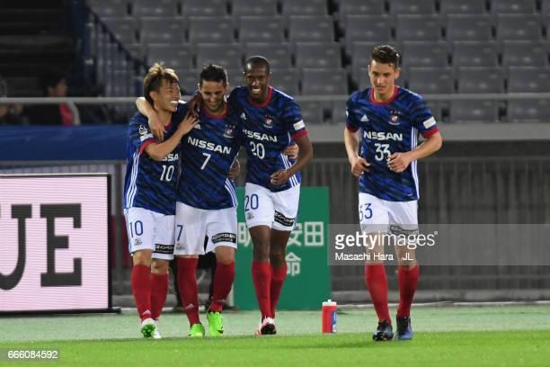Martinus of Yokohama F.Marinos celebrates scoring the opening goal with his team mates Hugo Vieira , David Babunski and Takashi Kanai of Yokohama...