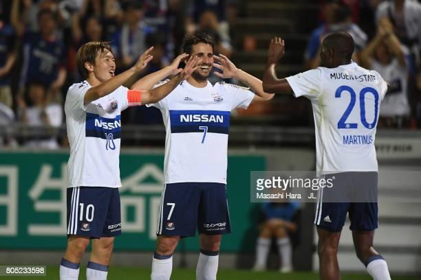 Martinus of Yokohama F.Marinos celebrates scoring the opening goal with his team mates Manabu Saito and Hugo Vieira during the J.League J1 match...