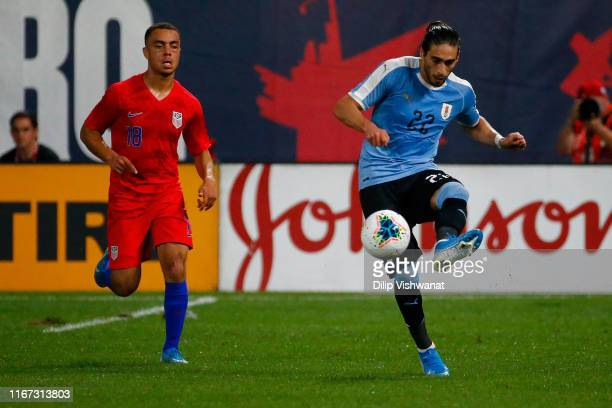 Martín Caceres of the Uruguay Men's National Team controls the ball against Sergiño Dest of the United States Mens National Team at Busch Stadium on...