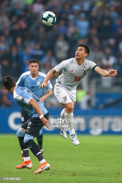 Martín Cáceres of Uruguay battles for the ball against Shinji Okazaki of Japan during the Copa America Brazil 2019 group C match between Uruguay and...