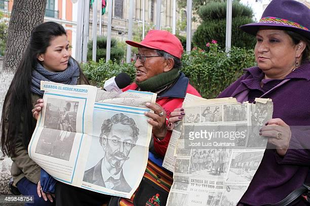 Martín Mamani Kama former President of the Junta de Vecinos de Bolivia and Ana María Díaz of Movimiento Al Socialismo display a La Razón newspaper...