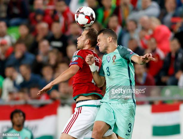 Marton Eppel of Hungary fights for the ball in the air with Pepe of Portugal during the FIFA 2018 World Cup Qualifier match between Hungary and...