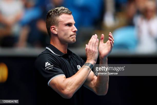 Marton Fucsovics of Hungary applauds fans following victory in his Men's Singles first round match against Denis Shapovalov of Canada on day one of...