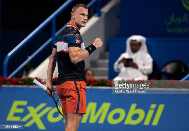 Marton Fucsovics of Hungary celebrates a point during his match against Novak Djokovic of Serbia during day three of the ATP Qatar ExxonMobil Open at...