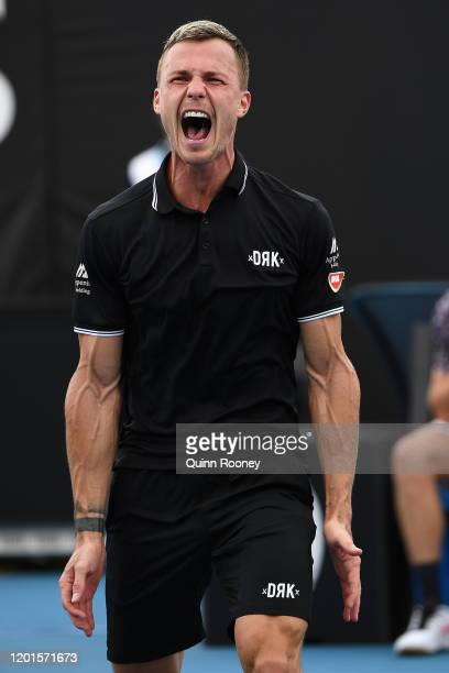 Marton Fucsovics of Hungary celebrates after winning match point during his Men's Singles third round match against Tommy Paul of the United States...