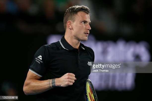 Marton Fucsovics of Hungary celebrates after winning the first set during his Men's Singles fourth round match against Roger Federer of Switzerland...