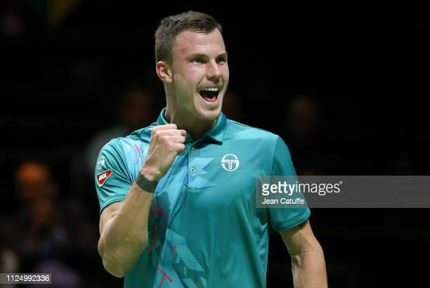 Marton Fucsovics of Hungary celebrates his victory over Nikoloz Basilashvili of Georgia in straight sets during Day 4 of the ABN AMRO World Tennis...