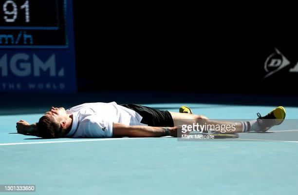 Marton Fucsovics of Hungary celebrates winning match point in his Men's Singles second round match against Stan Wawrinka of Switzerland during day...