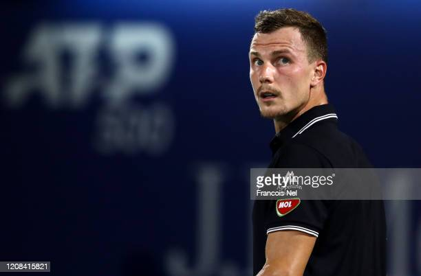 Marton Fucsovics of Hungary looks on against Gael Monfils of France during his men's singles match on Day Eight of the Dubai Duty Free Tennis at...