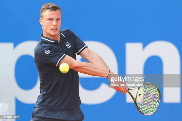 Marton Fucsovics of Hungary plays a back hand during his Quaterfinal match against Maximilian Marterer of Germany on day 7 of the BMW Open by FWU at...