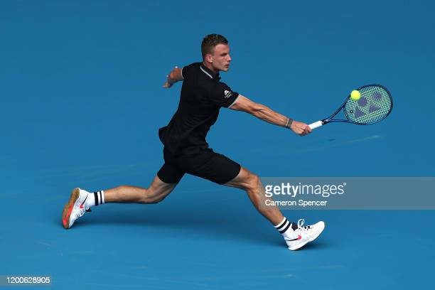 Marton Fucsovics of Hungary plays a backhand during his Men's Singles first round match against Denis Shapovalov of Canada on day one of the 2020...