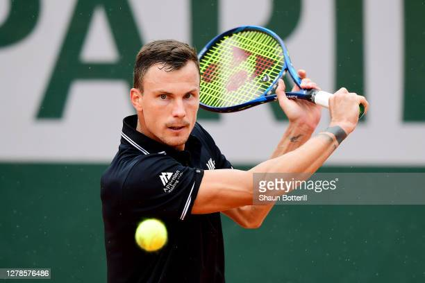 Marton Fucsovics of Hungary plays a backhand during his Men's Singles fourth round match against Andrey Rublev of Russia on day nine of the 2020...