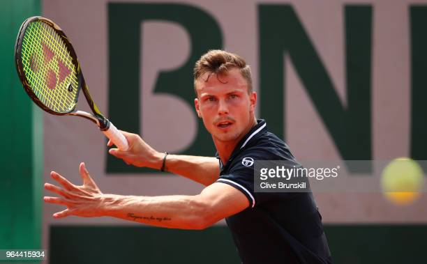 Marton Fucsovics of Hungary plays a backhand during his mens singles second round match against Kyle Edmund of Great Britain during day five of the...