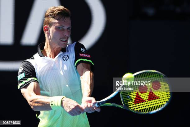 Marton Fucsovics of Hungary plays a backhand in his fourth round match against Roger Federer of Switzerland on day eight of the 2018 Australian Open...