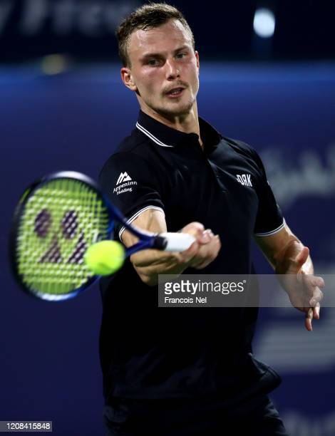 Marton Fucsovics of Hungary plays a forehand against Gael Monfils of France during his men's singles match on Day Eight of the Dubai Duty Free Tennis...