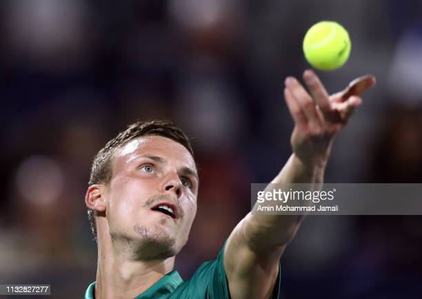 Marton Fucsovics of Hungary plays a forehand against Roger Federer of Switzerland during day twelve of the ATP Dubai Duty Free Tennis Championships...