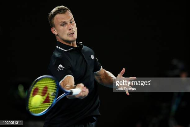 Marton Fucsovics of Hungary plays a forehand during his Men's Singles fourth round match against Roger Federer of Switzerland on day seven of the...