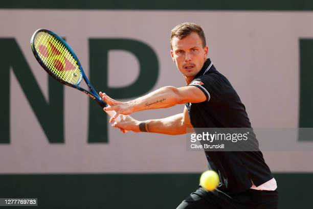 Marton Fucsovics of Hungary plays a forehand during his Men's Singles second round match against Albert Ramos-Vinolas of Spain on day five of the...