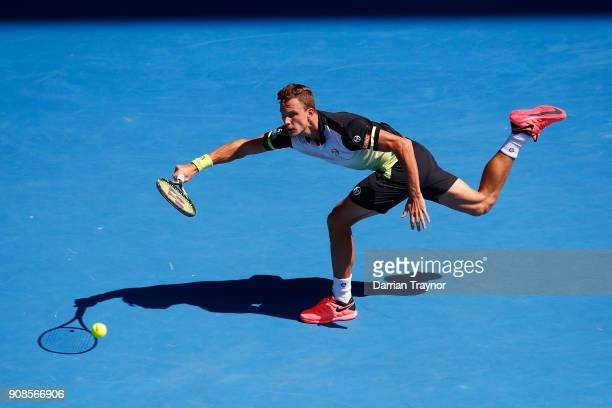 Marton Fucsovics of Hungary plays a forehand in his fourth round match against Roger Federer of Switzerland on day eight of the 2018 Australian Open...