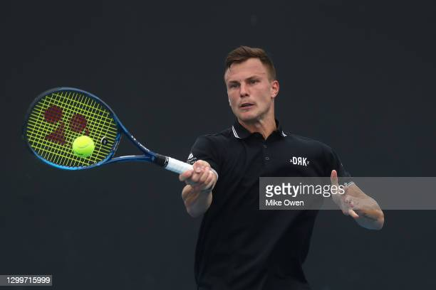 Marton Fucsovics of Hungary plays a forehand in his match against Marco Cecchinato of Italy during day one of the ATP 250 Murray River Open at...