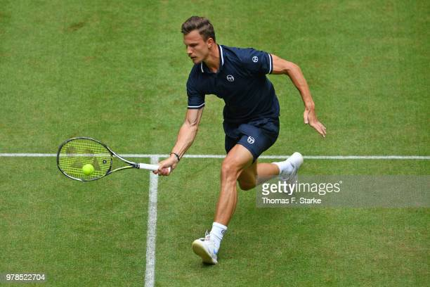 Marton Fucsovics of Hungary plays a forehand in his match against Philipp Kohlschreiber of Germany during day two of the Gerry Weber Open at Gerry...