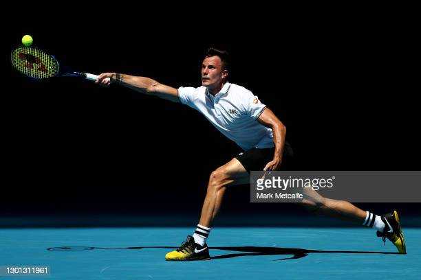 Marton Fucsovics of Hungary plays a forehand in his Men's Singles second round match against Stan Wawrinka of Switzerland during day three of the...