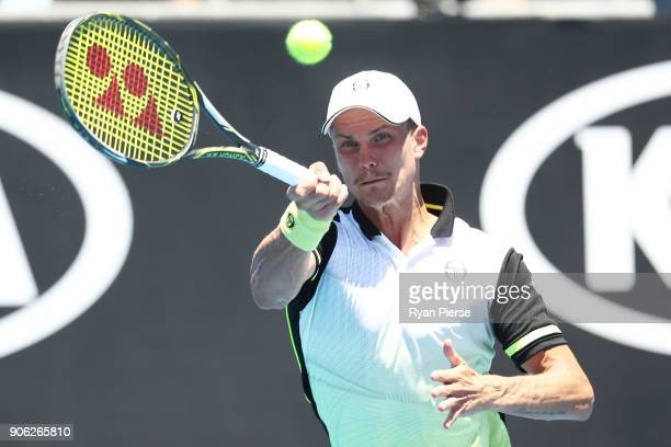Marton Fucsovics of Hungary plays a forehand in his second round match against Sam Querrey of the United States on day four of the 2018 Australian...