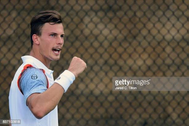 Marton Fucsovics of Hungary reacts after a point against Ernests Gulbis of Latvia during the third day of the WinstonSalem Open at Wake Forest...