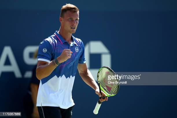 Marton Fucsovics of Hungary reacts during his men's singles first round match against Nikoloz Basilashvili of Georgia during day one of the 2019 US...