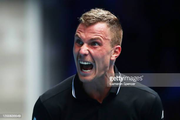 Marton Fucsovics of Hungary reacts during his Men's Singles first round match against Denis Shapovalov of Canada on day one of the 2020 Australian...